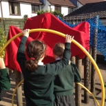 Children making a structure our of hoops