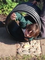 Child crawling through a tunnel